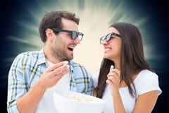Imagem composta dos pares novos atrativos que olham um filme 3d Fotos de Stock