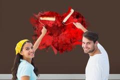 Imagem composta dos pares novos felizes que pintam junto Fotografia de Stock Royalty Free