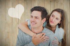 Imagem composta dos pares que abraçam com braços ao redor e que olham afastado Fotografia de Stock Royalty Free