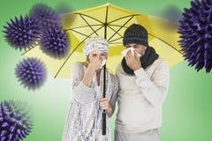 Imagem composta dos pares que espirram no tecido ao estar sob o guarda-chuva fotos de stock royalty free