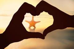 Imagem composta dos pares que fazem a forma do coração com mãos Fotos de Stock Royalty Free