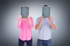 Imagem composta dos povos que guardam folhas sobre as caras Imagens de Stock
