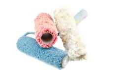 Imagem criativa da escova de pintura branca, vermelha e azul suja e reutilizada do rolo Fotos de Stock Royalty Free