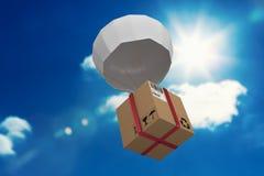 Imagem 3d composta da caixa de cartão levando do paraquedas Fotografia de Stock