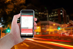 Imagem 3d composta da mão colhida que guarda o telefone celular Imagens de Stock Royalty Free