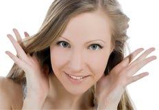 Imagem da cara de sorriso da mulher com mão ela para ouvir-se fotografia de stock