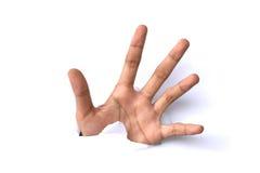 Imagem da mão humana que alcança para fora através do papel rasgado Imagens de Stock