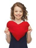 Menina com coração grande Fotos de Stock