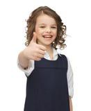 menina Pre-adolescente que mostra os polegares acima Fotos de Stock