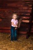 A menina em uma sega fotografia de stock