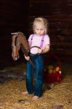 A menina em uma sega foto de stock royalty free