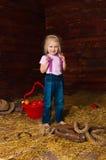A menina em uma sega imagens de stock royalty free