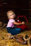 A menina em uma sega imagem de stock