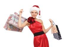 Imagem da mulher bonita com sacos de compras fotos de stock royalty free