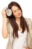 Imagem da mulher de negócios cansado com despertador Imagens de Stock Royalty Free