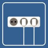 Imagem da tomada elétrica em um fundo azul Foto de Stock