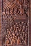 A imagem da vida da Buda é cinzelada na porta fotos de stock royalty free