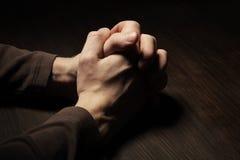 Imagem das mãos praying Imagem de Stock