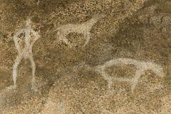 Imagem de um homem antigo na parede da caverna fotos de stock