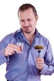Imagem de um homem com um vidro da vodca Imagem de Stock Royalty Free