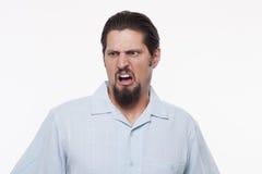 Imagem de um homem novo com levantamento aberto da boca contra o branco Imagens de Stock Royalty Free