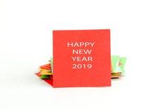 Imagem de um papel de nota vermelho com texto Foto de Stock
