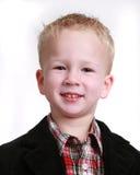 Imagem de um rapaz pequeno no branco Fotografia de Stock