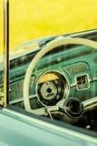 Imagem denominada retro do interior de um carro clássico fotografia de stock royalty free