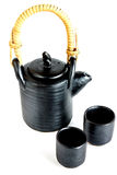 Imagem do bule e de xícaras de chá orientais tradicionais no backgro branco Foto de Stock Royalty Free