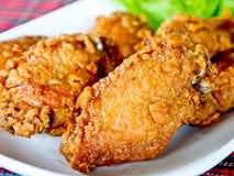 Imagem do close up das asas de galinha fritada Imagens de Stock