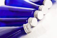 Imagem do close up de garrafas azuis Fotos de Stock Royalty Free