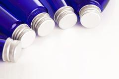 Imagem do close up de garrafas azuis Fotos de Stock