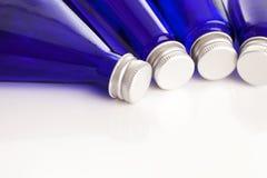 Imagem do close up de garrafas azuis Imagens de Stock Royalty Free