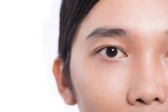 Imagem do close-up de um teenager& x27; olhos de s que olham a câmera imagem de stock royalty free