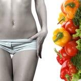 Imagem do conceito do alimento saudável e de uma barriga fêmea Foto de Stock Royalty Free