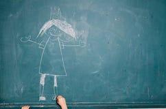 Imagem do desenho da criança no quadro foto de stock
