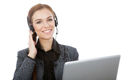 Imagem do operador fêmea de sorriso da linha aberta com fones de ouvido e fotografia de stock