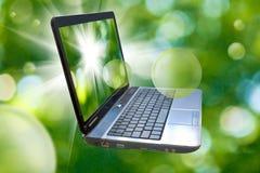 Imagem do portátil no fundo verde abstrato Imagem de Stock Royalty Free