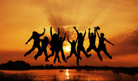 Imagem do salto do grupo das silhuetas Fotos de Stock