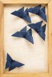 Imagem do vintage da obscuridade - borboletas azuis do origâmi Fotos de Stock Royalty Free