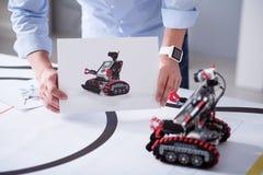 Imagem e um robô real do brinquedo Fotos de Stock Royalty Free