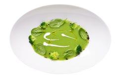 Imagem isolada da sopa de ervilha verde com teste padrão dos brócolis e do creme Fotografia de Stock