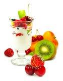 Imagem isolada do iogurte em um vidro com fruto em um fim branco do fundo acima fotografia de stock royalty free