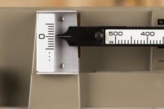 Imagem macro de uma escala número 5 do equilíbrio Imagem de Stock