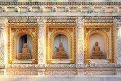 Imagem três de buddha na parede Fotografia de Stock