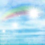 Imagen abstracta de un arco iris en el cielo azul con resplandor del sol Imágenes de archivo libres de regalías
