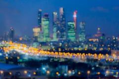 Imagen abstracta Defocused Efecto de Bokeh Luces de oro de la ciudad grande Paisaje, luces y Windows de la ciudad de la noche de  foto de archivo