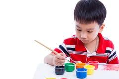 Imagen asiática del drenaje del muchacho usando los instrumentos de dibujo Fotos de archivo libres de regalías