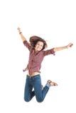 Imagen brillante de la mujer de salto feliz en camisa roja Fotografía de archivo