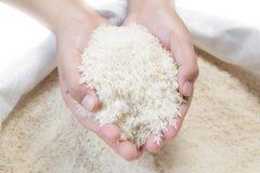Imagen com?n blanca del arroz a disposici?n - fotografía de archivo libre de regalías
